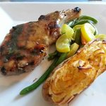 Pork loin chop with vegetables and twice-baked potato