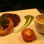 10oz Ribeye steak, crispy onion ring, spinach purée and whiskey pepper sauce