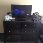 Dresser with average flat screen. No HBO though.