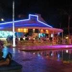 One of the bars at the pool area at night