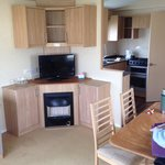 Lounge, kitchen area of caravan. Lovely size