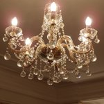 5-6 chandelliers throuhout the suite
