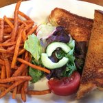 grilled cheese, sides of salad, sweet potato fries