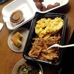 Hushpuppies, Mac & Cheese, Cornbread, Pulled Chicken, Collards, and BBQ Sauce