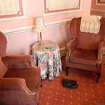 Room 223 small table and sitting chairs in room