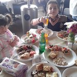 My children enjoy their meal in  ORJUWAN LOUNGE
