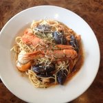Spaghetti Marinara with fresh mussels, clams, prawns served with pasts, parmesan & herbs topped