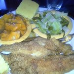 Catfish, cabbage, and sweet potatoes