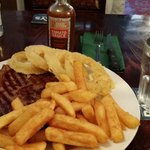 Steak perfectly cooked with some of the best chips onions and tomato sauce I have ever tasted!