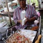 Local preparing delicious food at the Tha Kha floating market