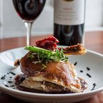 Roast Half Crispy Duck with a bottle of our House Red