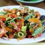 Fish with tomato, herbs, etc..