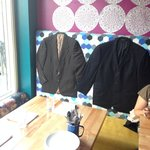 coats sewn into the back of the banquette