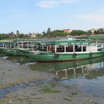 Touring boats moored on the Thu Bon River