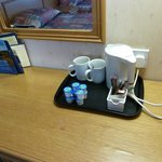 odd mugs, unwrapped tea bags on the tray