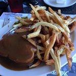 Hot hamburger sandwich with home-cut fries.