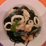 Squid ink black spaghetti with seafood and cream sauce.