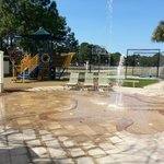 One of the many activities, a kids splash pad, a climbing structure, and a basketball court