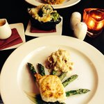 My halibut on asparagus gorgeous dish her sea bass dish with side dish on between.. Enjoyed very