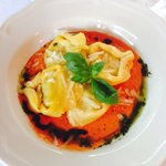 Tortelloni stuffed with mushrooms in tomato sauce.