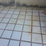 yellowed/rusted chaise/tiles on patio