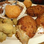 Crab cakes in the shell with hush puppies and fried okra