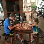 kids playing checkers outside tasting area