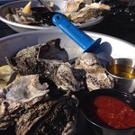 Raw or steamed oysters! Nice relaxing afternoon on the roof top bar, listening to local music, a