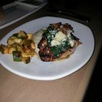 grilled salmon topped with spinach, gorgonzola and bacon