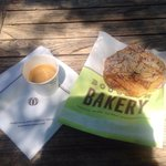 Chocolate-almond croissant and a shot of espresso enjoyed al fresco on a bench outside the baker