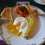 Breakfast with smoked haddock, egg and tomato