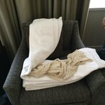 A gross ladies blouse folded in the fresh towels we ordered