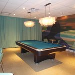 A pool table in the bar area awaits guests