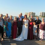 wedding guests on fishing dock