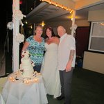 bride and groom with Maria who made this wonderful cake