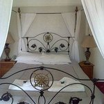 Just one of our four poster rooms.