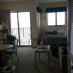 Bed and living room and balcony oceanfront sunsuite room 804