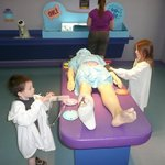 """kids playing doctor with the life size """"body"""""""