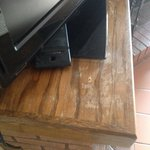 The wood work is old and stained on our TV stand
