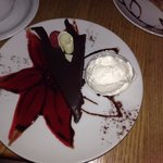 Chocolate mouse. Whipped cream and raspberry sauce was soo good!