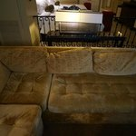 """I call it """"slouchy couch"""". It was all this way. And the light was bent to the side. Details."""