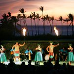 The beautiful sunset skies of Anaeho'omalu Bay is the backdrop to our show!