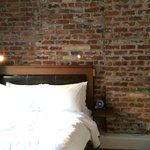 Bed and the beautiful brick wall