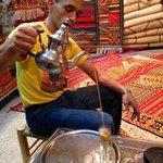 Mohammad serving tea.
