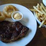 12 ounce Sirloin Steak with homemade fries, onion rings, and garlic butter.