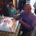 Birthday boy cutting his cake.
