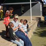 My son with kids at Kliptown, they loved seeing pictures of themselves taken with his phone came