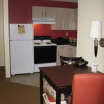 full kitchen and fridge with ice maker