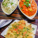 On the top, jeera rice and mixed vegetable curry; below: masala uttapham.
