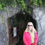 The entrance to the church grounds is a rock tunnel.